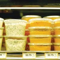 Food containers such as these may soon be made mostly from corn and other plant-based materials.