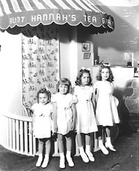 """From the Herbert Georg collection, the Hunn girls at Aunt Hannah's Baby Shop. From left: Marjorie Ellen """"Marjie,"""" 3; Alice Claire, 4; Paula Anne, 6; Mary Louise """"Mitzi,"""" 8."""