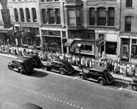 Springfield residents line up to shop at the Monroe Meat Market on July 3, 1946.