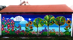 Jaymee Laws, a painter and mixed media artist who will be featured during Downtown Art Walk, painted this garden mural during the summer in her alleyway for people to enjoy while driving by.