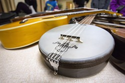 A banjolele is seen in a gathering of ukeleles owned by members of the Ukelele Players of the Palouse during practice Thursday at Simpson United Methodist Church in Pullman. - DEAN HARE