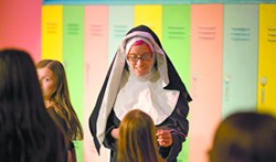 """Petra Berry, as Miss Clavel, (center) talks to her students before leaving the zoo during a rehearsal of """"Madeline's Christmas"""" in Pullman on Monday. - GEOFF CRIMMINS"""