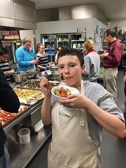 chefs-challenge_middle-school-culinary-club-student-enjoys-r.jpg