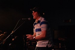 Larson Hicks speaks on stage at a Yarn Owl and Helio Sequence concert in 2009.