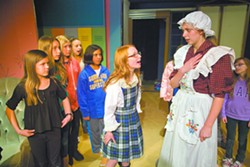 """Claire Cochran, as Madeline, (center) and Libby Aiken, as Mrs. Murphy (right) talk during a rehearsal of """"Madeline's Christmas"""" in Pullman on Monday. - GEOFF CRIMMINS"""