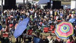 Concert goers at Rocking on the River in Clarkston, soak up the sunshine and suds and the music in 2011. - TRIBUNE/STEVE HANKS