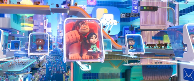 """This image released by Disney shows characters, Ralph, voiced by John C. Reilly , center left, and Vanellope von Schweetz, voiced by Sarah Silverman in a scene from """"Ralph Breaks the Internet."""" - DISNEY VIA AP"""