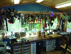 """The walls in Ellingson's Spokane workshop, """"The Perch,"""" are layered with materials."""