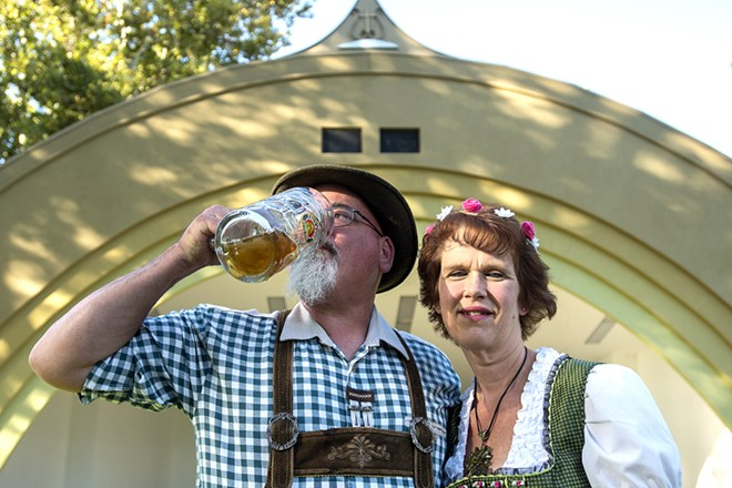 Sporting German lederhosen Pete and Nancy Broyles pose for a portrait at Pioneer Park in Lewiston where Oktoberfest takes place this weekend. - PHOTO PETE CASTER