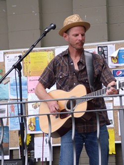 Tom Drake performs at the Moscow Food Co-Op.