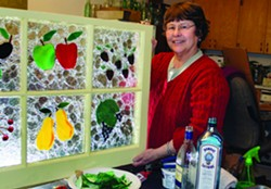 Glass artist Pam Arborgreen with one of her finished pieces in her studio. - KAI EISELEIN
