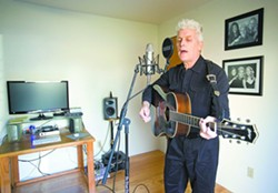 """John Cronin performs in the recording studio in his Moscow home on Friday. Cronin released a roots rock album, """"The Museum of Broken Hearts,"""" in December. - GEOFF CRIMMINS"""