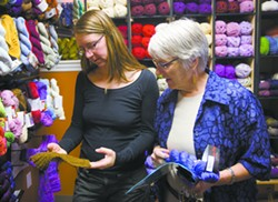 Owner Shelley Stone, left, helps customer Liz Brandt at the Yarn Underground in Moscow. Stone is organizing the Palouse Fiber Arts Festival June 14-15. - GEOFF CRIMMINS