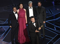 """CORRECTS IDS - Sebastian Lelio, foreground center, and Juan de Dios Larrain, background from left, Daniela Vega, Francisco Reyes, and Pablo Larrain accept the award for best foreign language film for """"A Fantastic Woman"""" at the Oscars on Sunday, March 4, 2018, at the Dolby Theatre in Los Angeles. - PHOTO BY CHRIS PIZZELLO/INVISION/AP"""