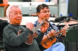 Bill Ka'aihue and Margaret Guzman strum their ukuleles. - TRIBUNE/STEVE HANKS
