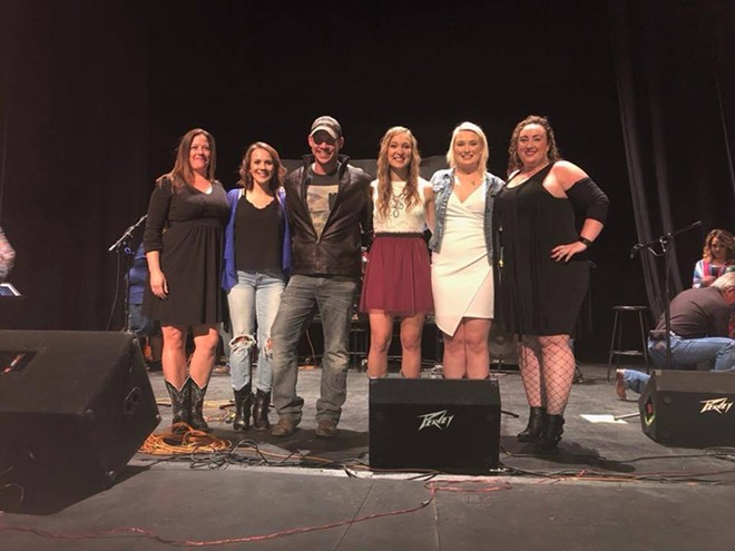 """Chad Bramlet on stage with other contestants Saturday, Oct. 14 at the Raton, New Mexico """"Country Showdown"""" semi-finals."""