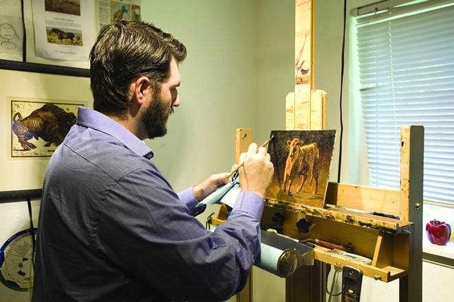 Tobias Sauer works on an oil painting he just started at his home in Moscow May 2. - GEOFF CRIMMINS