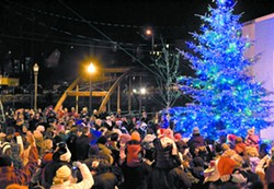 People gather for the Tree Lighting Ceremony in 2009 at the Pine Street Plaza in Pullman. - DEAN HARE