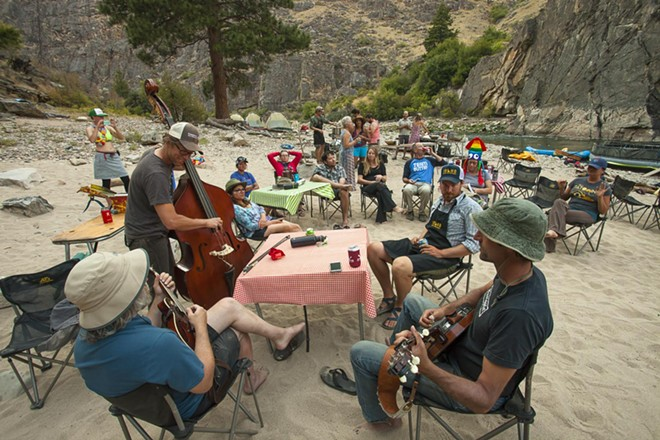 Members of the group Hot Buttered Rum play along Idaho's Middle Fork of the Salmon River in 2016. The raft trip was part of Pickin' on the Middle Fork, a series developed by Idaho River Adventures that features bands as part of the outdoor experience. - ROBB HIRSCH