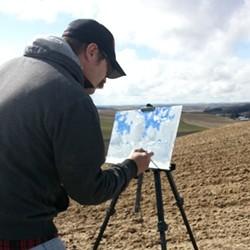 Aaron Johnson paints plein air in a Palouse-area field.