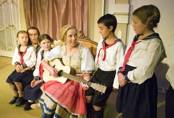 """Katie McDougall as Maria Rainer sings with the Von Trapp children in a scene from the Regional Theatre of the Palouse's production of """"The Sound of Music."""" - GEOFF CRIMMINS"""