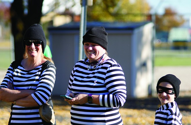 Teri Remsburg, left, Brenda Clements and Lucas Clements wait for the start of the Cops and Robbers Fun Run Saturday afternoon in Moscow. - KAI EISELEIN