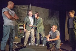 "Capt. John ""Trapper John"" McIntyre, center left, played by Christopher Burns, and Capt. Benjamin Franklin ""Hawkeye"" Pierce embrace while watched by Capt. John ""Ugly"" Black, left, played by Brandon Dudley, Capt. Augustus Bedford ""Duke"" Forrest, far right, played by Jonathan Shumate, and Capt. Walter ""Walt"" Waldowski, played by Michael Baszler, during rehearsal for the Pullman Civic Theater production of M*A*S*H on Thursday at the Nye Street Theatre in Pullman."