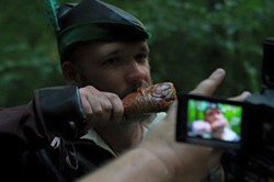 """Nickles plays a turkey leg eating henchman in the music video for """"Ramblin'.""""."""