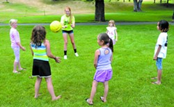Chloe Kirk conducts agility drills with girls, typical of the active games played during both of the two hour sessions each Tuesday through Saturday. - TRIBUNE/BARRY KOUGH