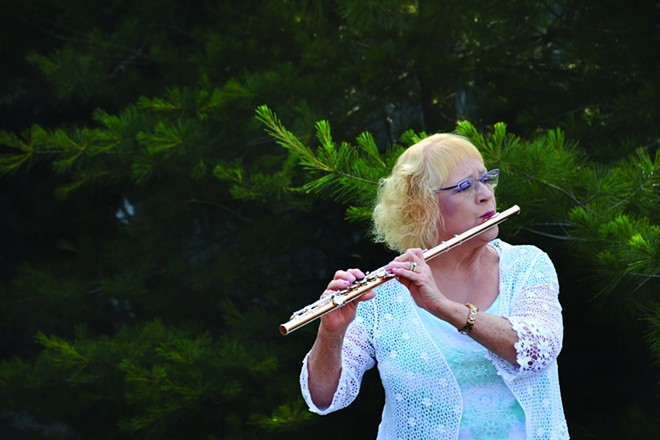 Washington-Idaho Symphony musician Ann Yasinitsky will play the flute in the garden of Mary and Nick Hasselstrom in Clarkston during the symphony fundraiser Music in the Garden Saturday. - PHOTO INLAND 360