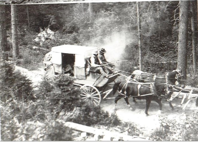 A passenger stage navigates the Clearwater to Elk City Wagon Road in the late 1800s. - PHOTO COURTESY DANA LOHREY