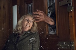 """This image released by Universal Pictures shows Jamie Lee Curtis in a scene from """"Halloween."""" (Ryan Green/Universal Pictures via AP) - RYAN GREEN/UNIVERSAL PICTURES VIA AP"""