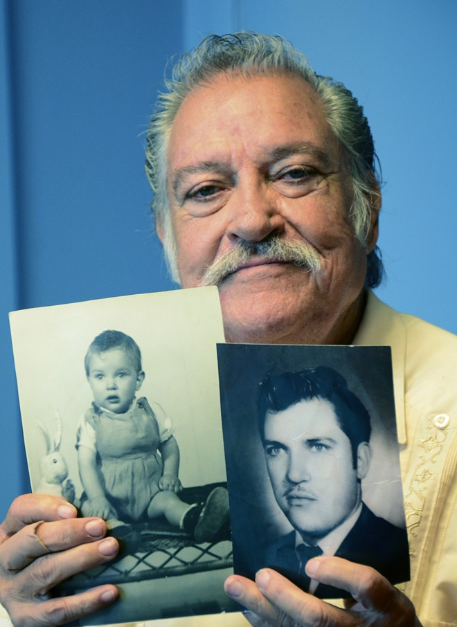 Jose Murillo holds photos of himself as a toddler and a young man.