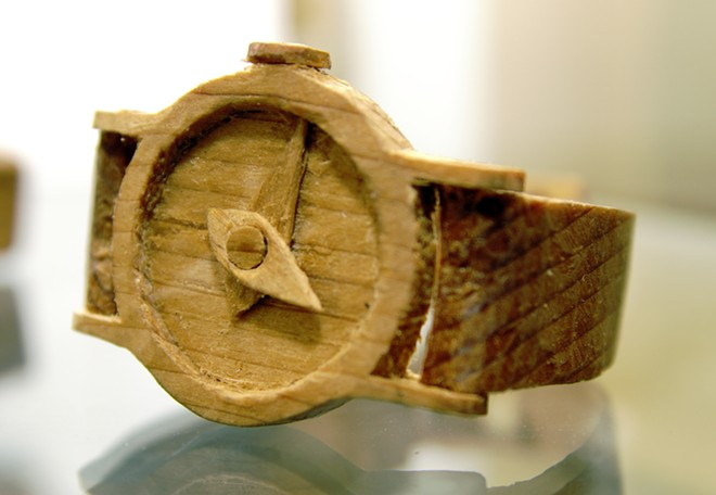 A wristwatch carved by Ted Kelchner on display at the Potlatch Library., - KAI EISELEIN/DAILY NEWS