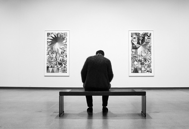 A man contemplates prints by artist Polly Apfelbaum during an opening reception for the exhibit at the Jordan Schnitzer Museum of Art at Washington State University September 4. - KAI EISELEIN/DAILY NEWS