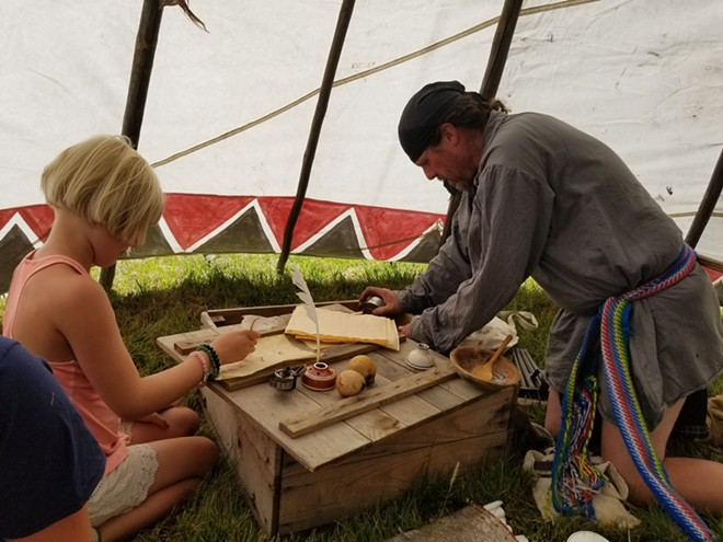 At Little House Day 2018 a trappers tepee is filled with items from the past.