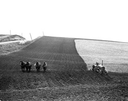 This National Archives photo shows farmers using both a horse-drawn plow and tractor to till a field in Shelby County, Iowa, in 1941. This image is part of the Smithsonian traveling exhibit to be on display at the Lewis-Clark Center for Arts & History in Lewiston.