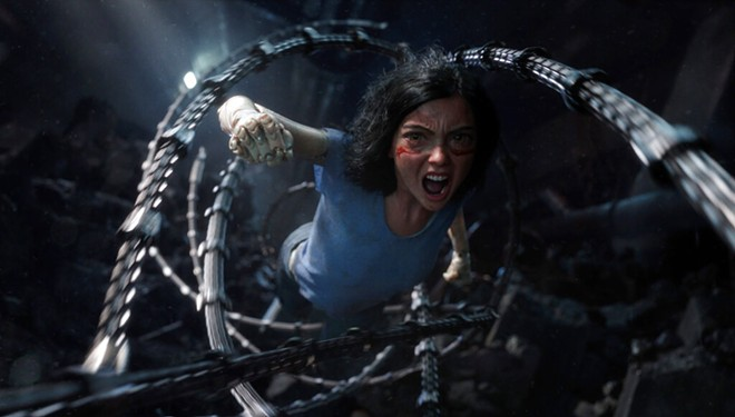"""This image released by Twentieth Century Fox shows the character Alita, voiced by Rosa Salazar, in a scene from """"Alita: Battle Angel."""" - TWENTIETH CENTURY FOX VIA AP"""