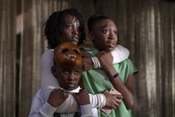 """This image released by Universal Pictures shows, from left, Evan Alex, Lupita Nyong'o and Shahadi Wright Joseph in a scene from """"Us,"""" written, produced and directed by Jordan Peele. (Claudette Barius/Universal Pictures via AP) - CLAUDETTE BARIUS/UNIVERSAL PICTURES VIA AP"""