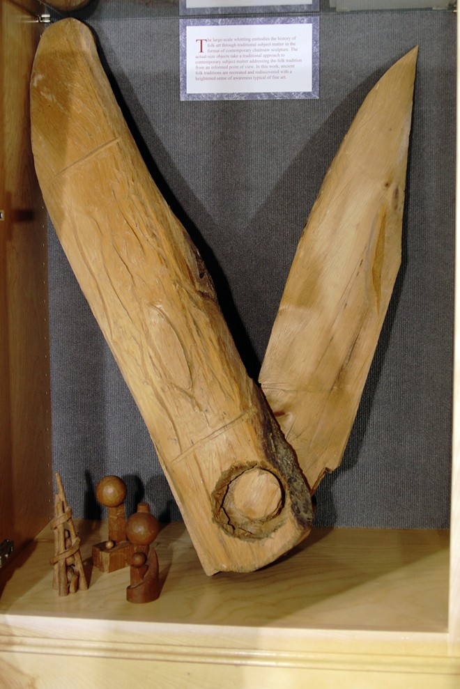 A giant pocketknife carved by Ted Kelchner fills a display cabinet at the Potlatch Library., - KAI EISELEIN/DAILY NEWS