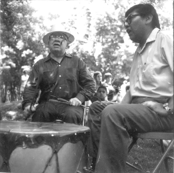 Rick Ellenwood (right) with Cy Red Elk (left) around the big drum circa 1970.