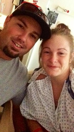 Chad and Jordyn Edwards in the hospital after she was bitten by a rattlesnake.