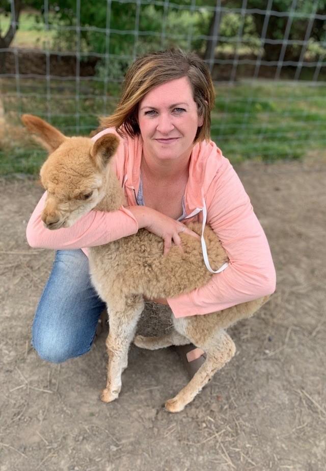 Katie DeWinkle with Brilliant Sunrise the alpaca.