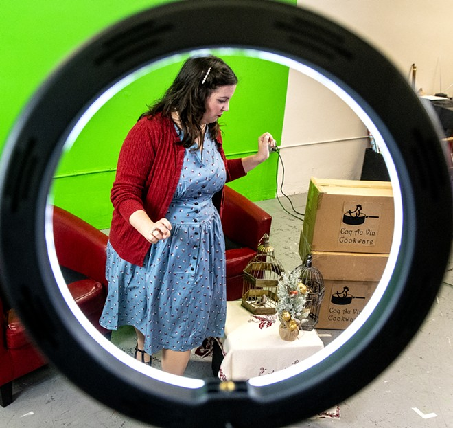 """Gabi Segren is seen through a ring light during a rehearsal of the """"The Twelve Days of Christmas"""" at the Lewiston Civic Theater offices on Sunday, Nov. 15. - AUGUST FRANK/TRIBUNE"""