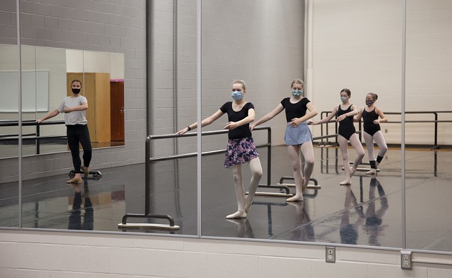 Instructor Colleen Bialas leads Festival Dance & Performing Arts students in a ballet class in Moscow. The nonprofit group has reduced the size of its classes and added additional safety measures as part of precautions during the pandemic.
