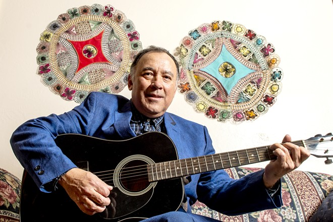 """Edgar Galeano sits in his home for a portrait on Monday. Galeano's song """"Pájaro Choguy"""" was included in a Latin grammy-nominated album. August Frank/Tribune - AUGUST FRANK/TRIBUNE"""