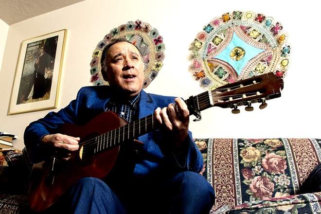 """Edgar Galeano sings his song """"Pájaro Choguy"""" which was included in a grammy-nominated Latin album, at his home on Monday. august Frank/Tribune - AUGUST FRANK/TRIBUNE"""