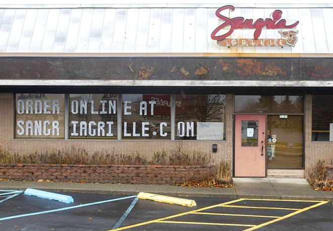 A sign in the window at Sangria Grille reminds customers that they can order online on Thursday in Moscow. - AP