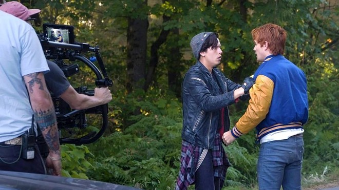 """Cole Sprouse and K.J. Apa on the set of the CW's TV show """"Riverdale"""" in a photo from Facebook. """"Riverdale"""" is filmed in Vancouver, British Columbia, Canada. Border closures are putting production on hold for many projects in the TV and film industry."""