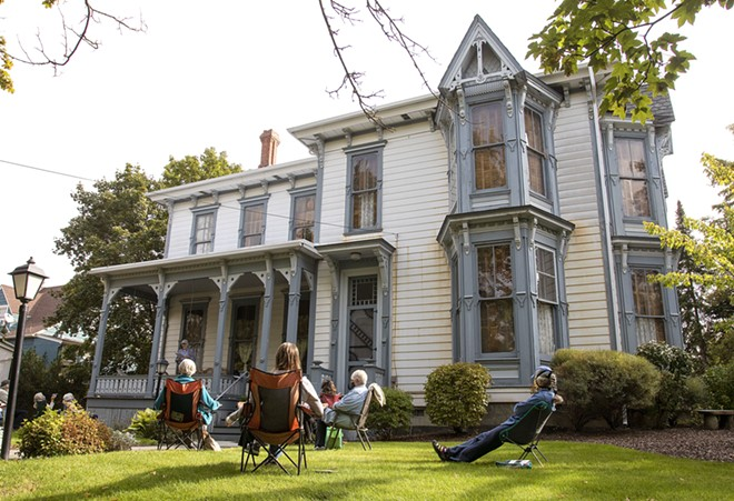 """Members of Lula's Library book group listen while Steve Talbott talks about homesteading on Wednesday, Sept. 23, outside McConnell Mansion in Moscow. The group is reading """"Four Girls On A Homestead,"""" by Carol Ryrie Brink. Geoff Crimmins/Moscow-Pullman Daily News - GEOFF CRIMMINS/DAILY NEWS"""